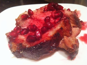 Pomegranate-Glazed Pork Crown Roast Slice