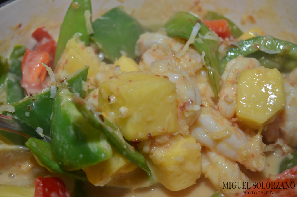 ... shrimp, vegetables, pineapple and toasted coconut in a Thai curry